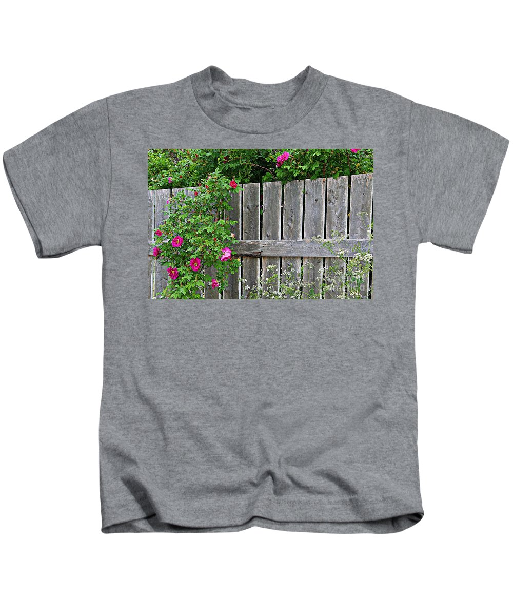 Wild Roses And Weathered Fence Kids T-Shirt featuring the photograph Wild Roses And Weathered Fence by Barbara Griffin
