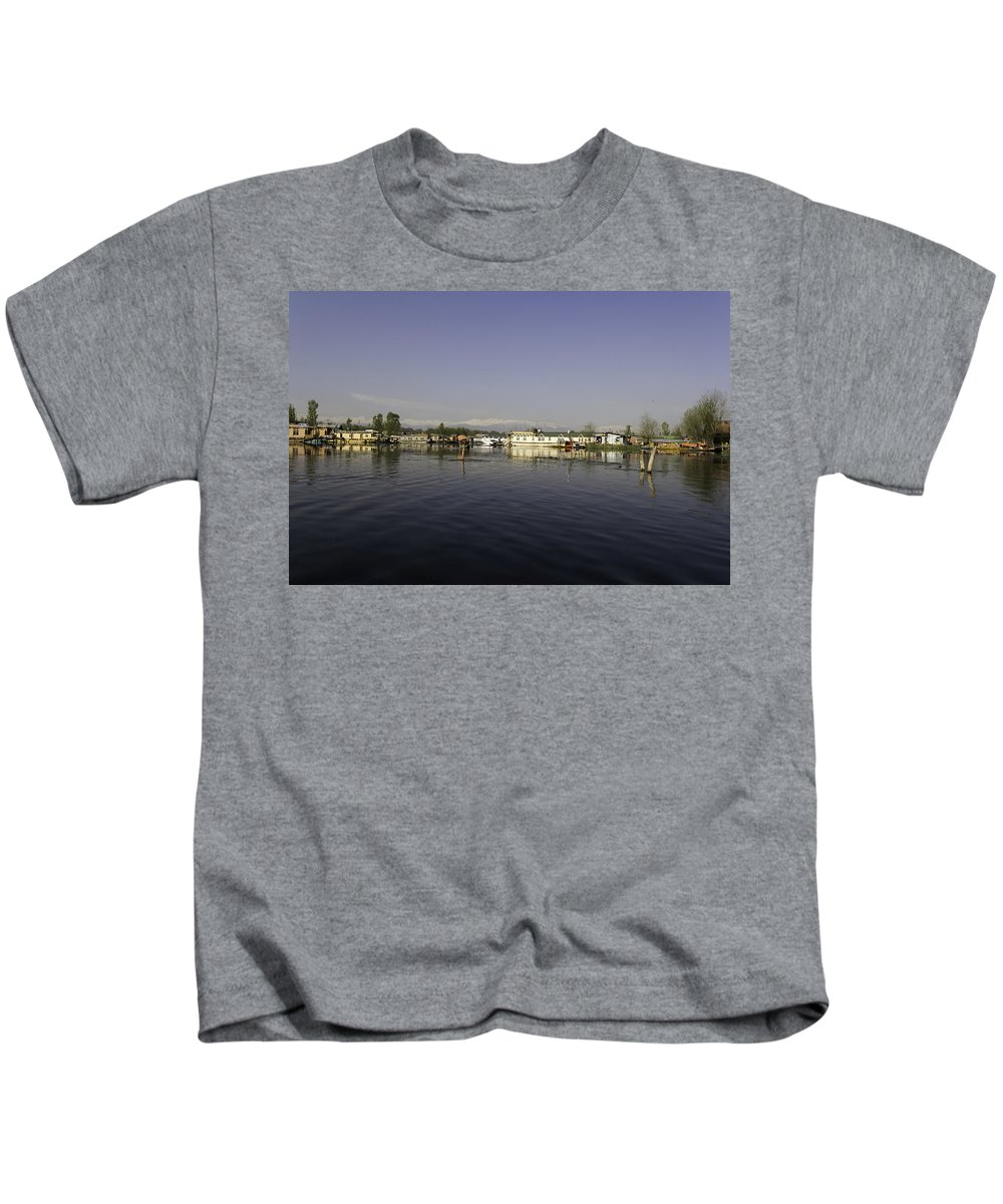 Beautiful Scene Kids T-Shirt featuring the photograph Wooden Logs Mounted In The Middle Of The Dal Lake In Srinagar by Ashish Agarwal