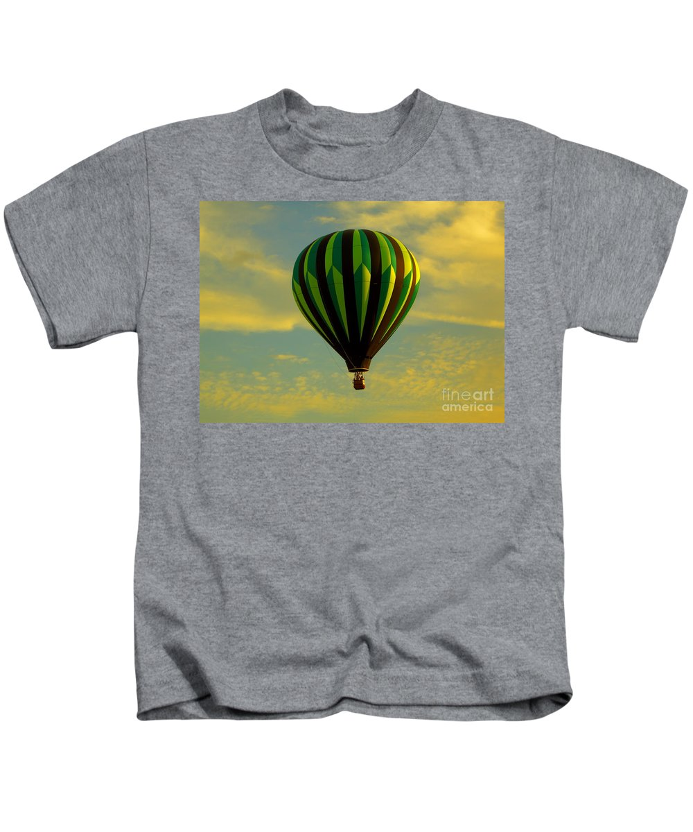 Balloon Race Kids T-Shirt featuring the photograph Balloon Ride Through Gold Clouds by Robert Frederick