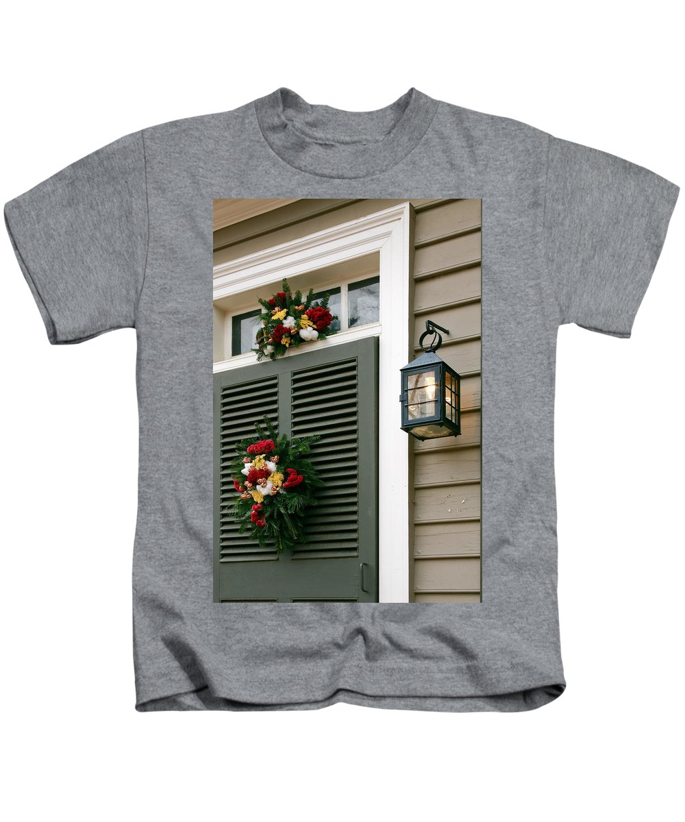 Wreaths Kids T-Shirt featuring the photograph Door At Christmas by Sally Weigand