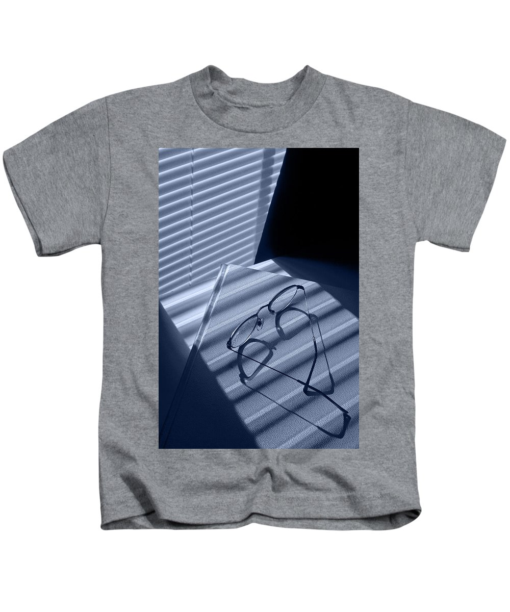 Art Kids T-Shirt featuring the photograph Eye Glasses Book And Venetian Blind In Blue by Randall Nyhof