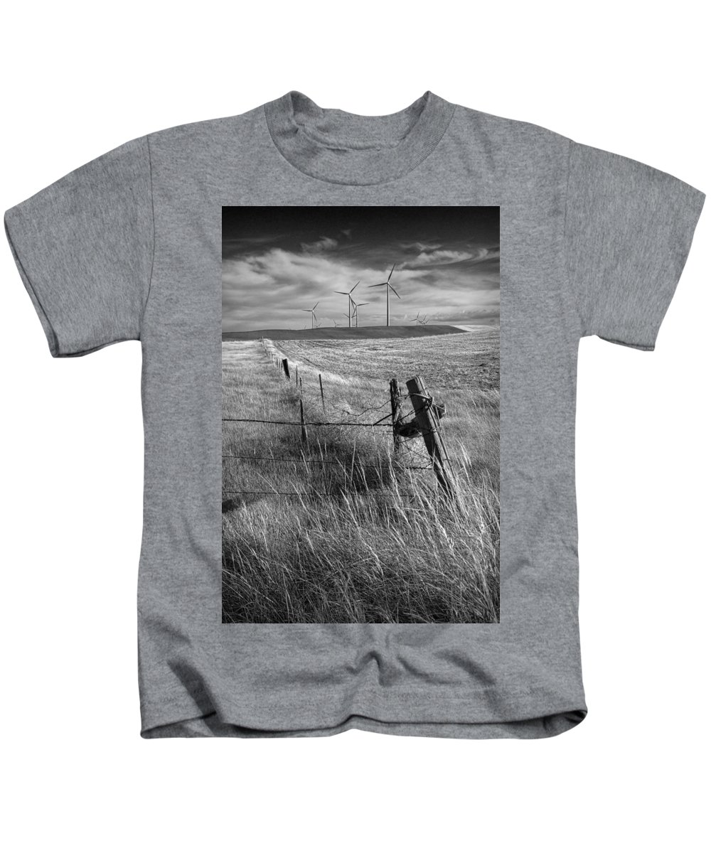 Power Kids T-Shirt featuring the photograph Fence Corner And Wind Turbines On A Farm In Alberta by Randall Nyhof