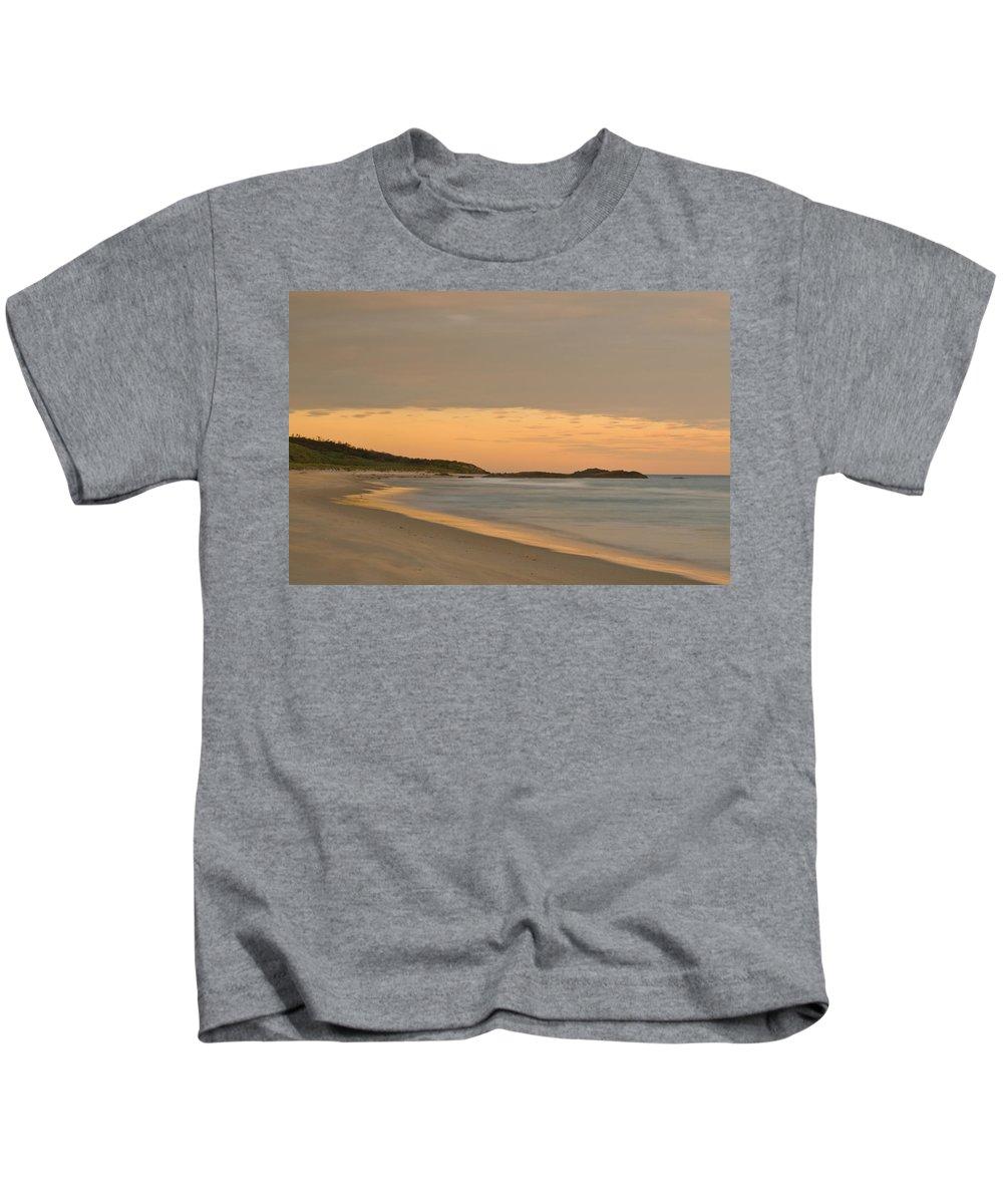 Background Kids T-Shirt featuring the photograph Golden Light After A Sunset At A Beach by U Schade