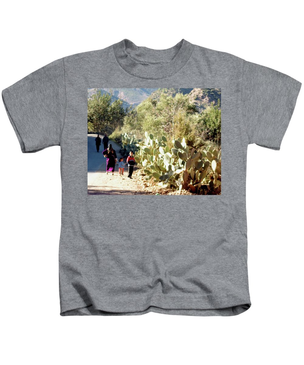 Travel Kids T-Shirt featuring the photograph Moroccan People And Cacti by Miki De Goodaboom