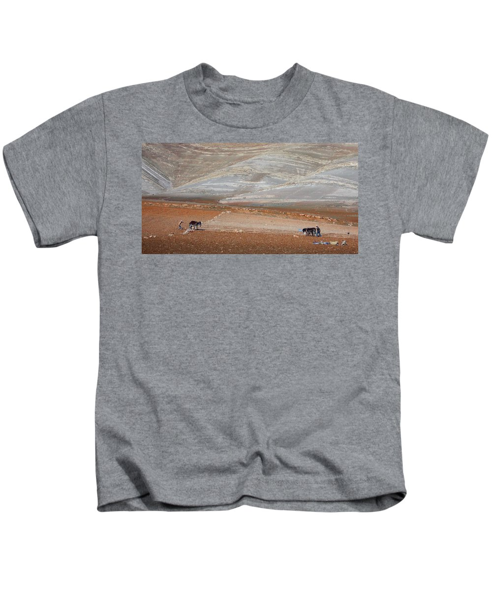 Travel Kids T-Shirt featuring the photograph Ploughing In The Atlas Mountains by Miki De Goodaboom