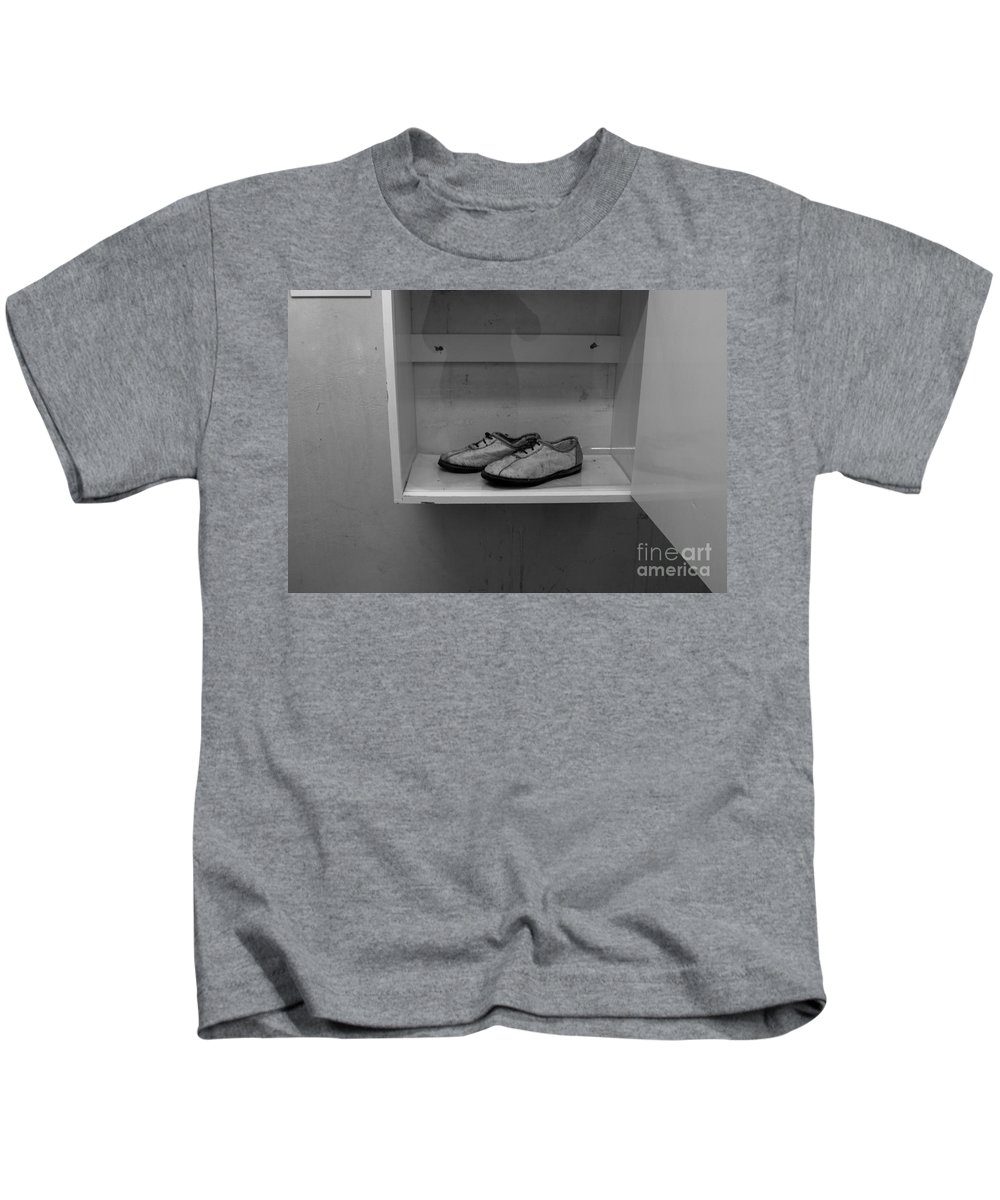 Robben Island Kids T-Shirt featuring the photograph Prisoners Shoes by Aidan Moran