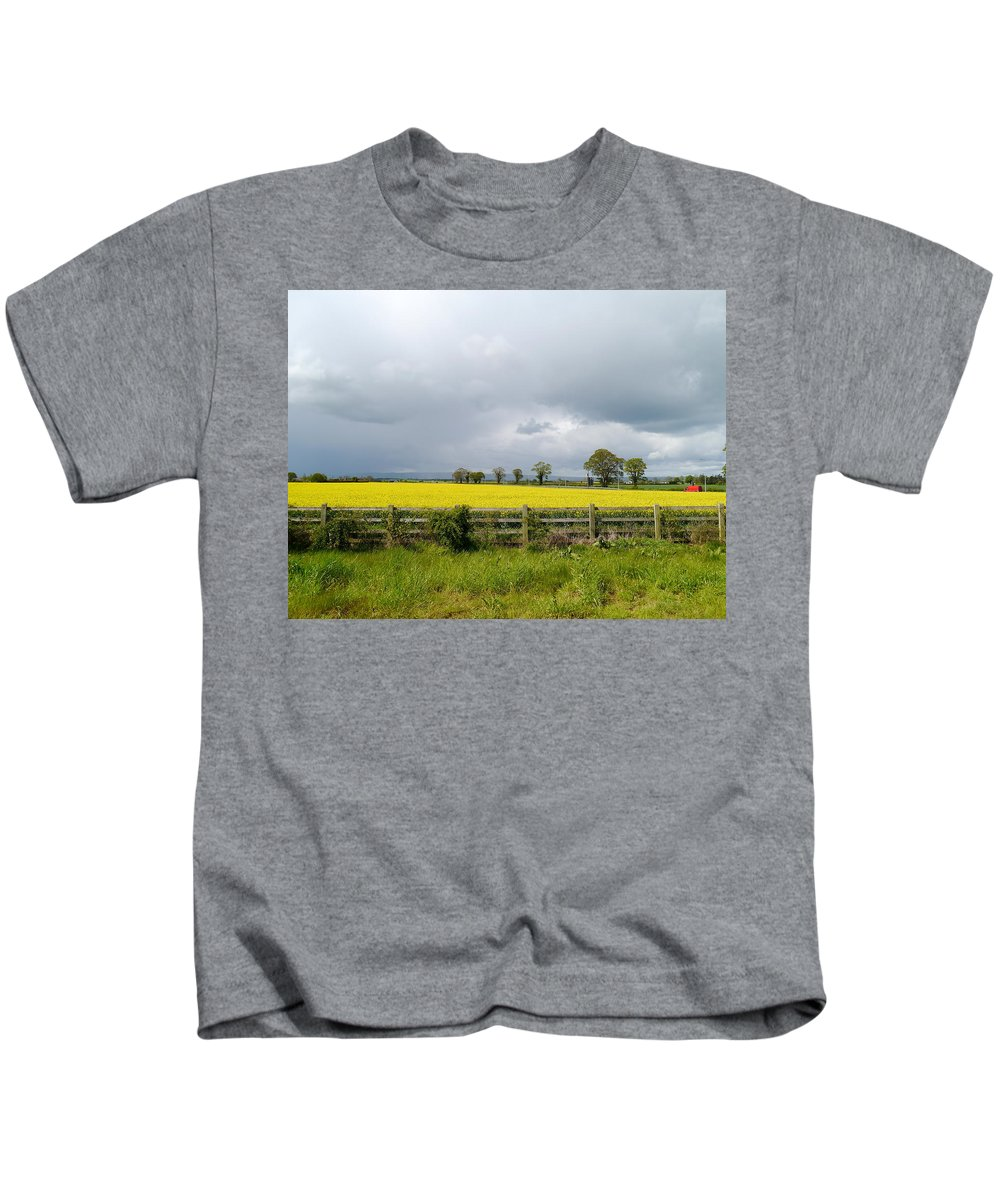 Canola Field Kids T-Shirt featuring the photograph Rain Clouds Over Canola Field by Christiane Schulze Art And Photography