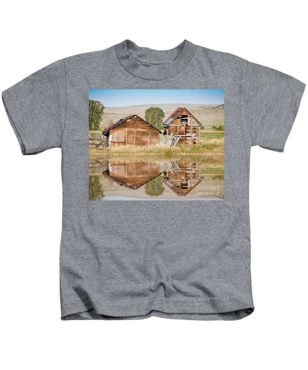 Fine Art Kids T-Shirt featuring the photograph Reflection Of An Old Building by Donna Greene