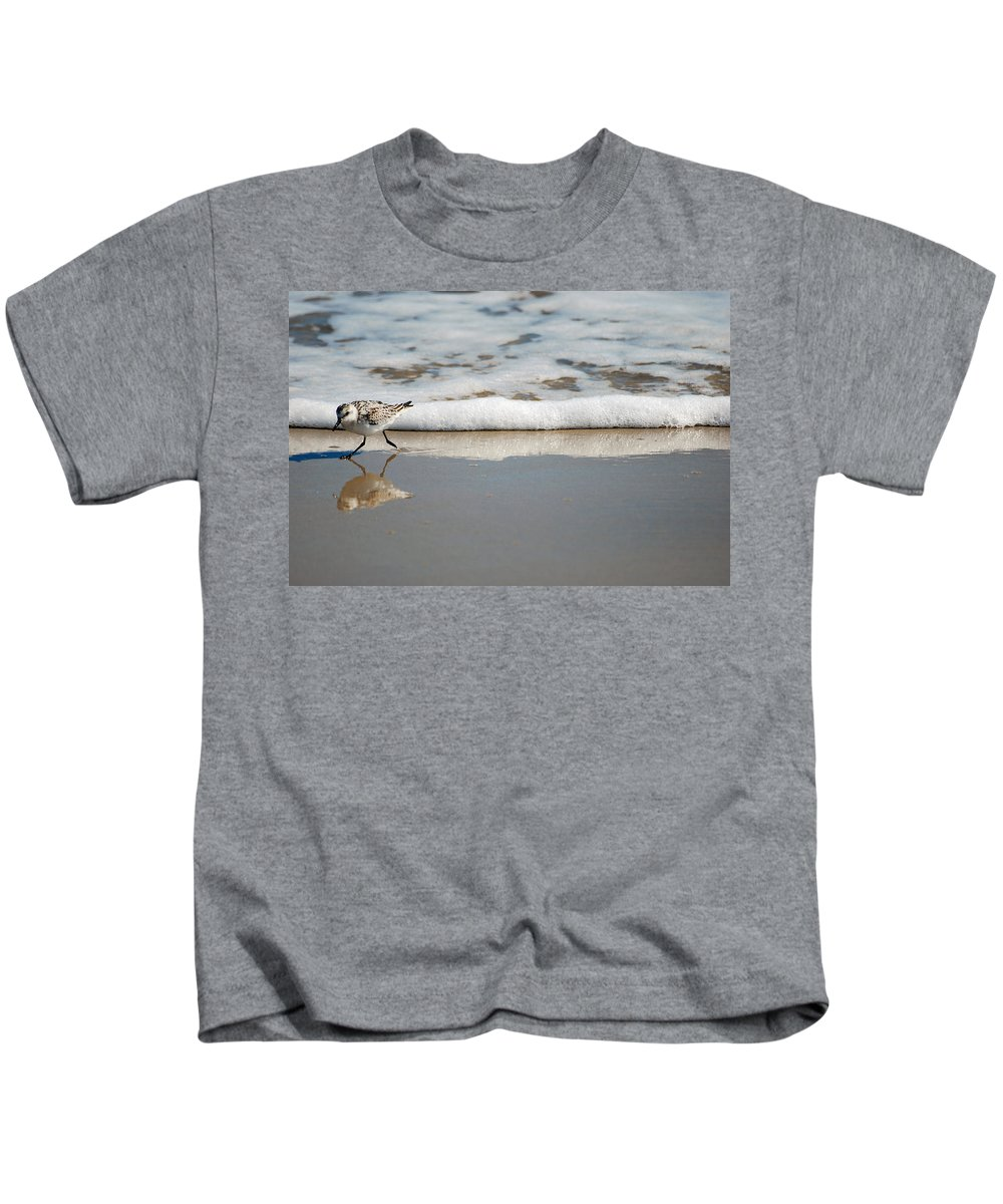 Sandpiper Kids T-Shirt featuring the photograph The Lone Sandpiper by Lori Tambakis