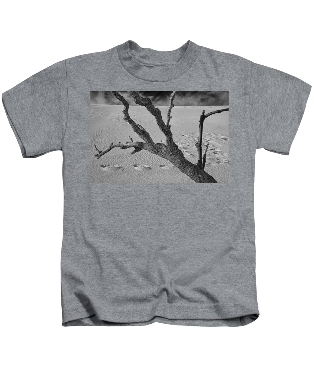 Art Kids T-Shirt featuring the photograph Tree Branch And Footprints On Sleeping Bear Dunes by Randall Nyhof