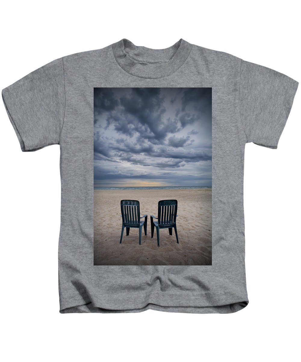 Art Kids T-Shirt featuring the photograph Two Deck Chairs At Sunrise On The Beach by Randall Nyhof