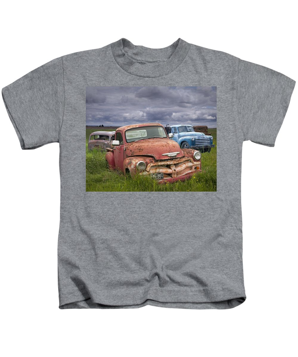 Art Kids T-Shirt featuring the photograph Vintage Auto Junk Yard by Randall Nyhof