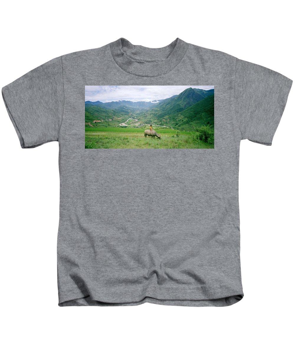 Asia Kids T-Shirt featuring the photograph Water Buffalo Boy by Shaun Higson