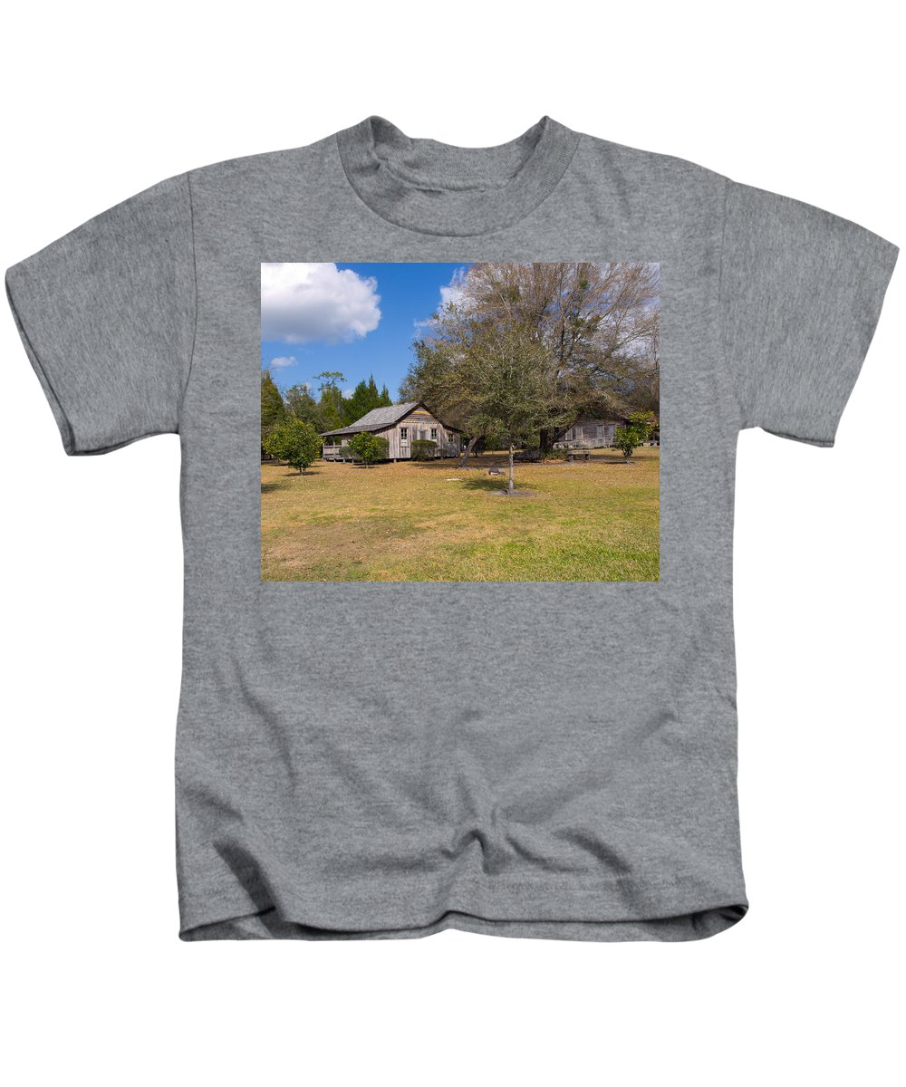 Cabin Kids T-Shirt featuring the photograph 1927 Woods Home In Christmas Florida by Allan Hughes