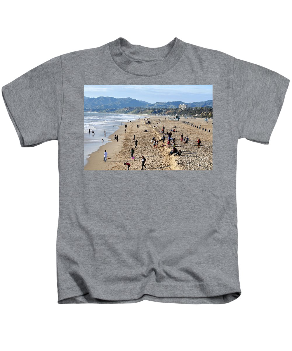 Clay Kids T-Shirt featuring the photograph A Day At The Beach In Santa Monica by Clayton Bruster