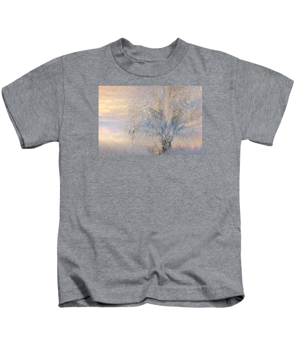 Winter Landscape Fantasy Kids T-Shirt featuring the digital art A Shimmering Light by Linda Murphy