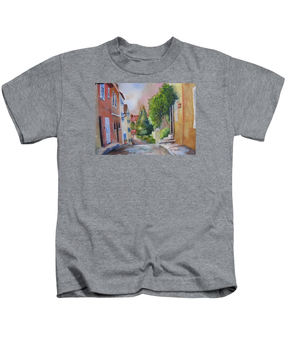 Cityscapes. Architecture Kids T-Shirt featuring the painting A Walk In The Village by Karen Stark