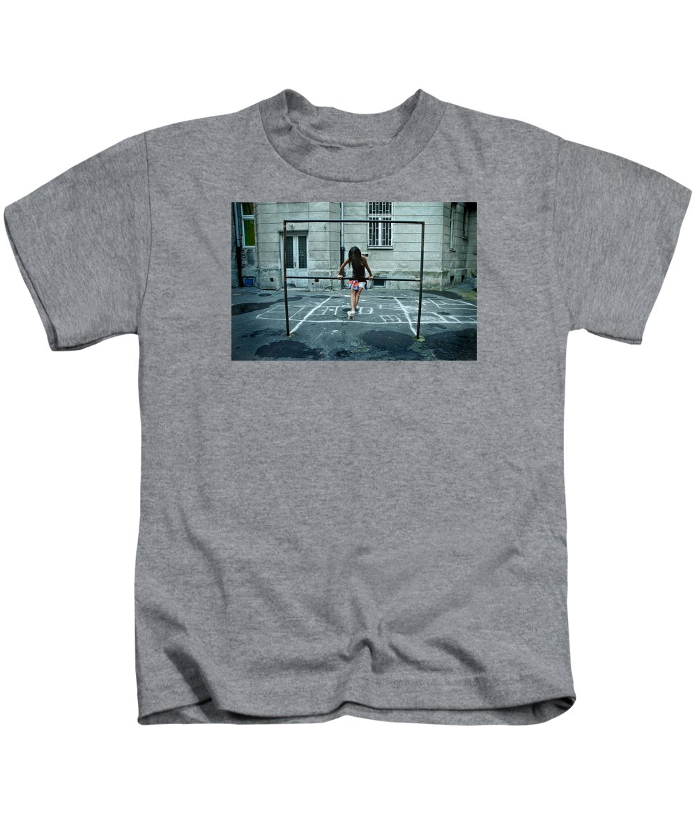 Children Kids T-Shirt featuring the photograph Ana At The Barre by Michael Ziegler