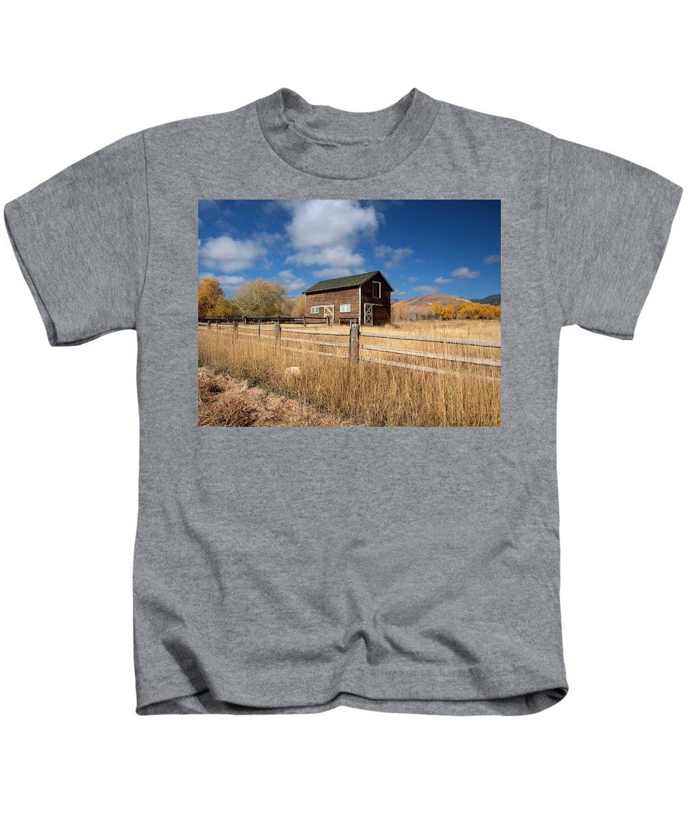 Utah Kids T-Shirt featuring the photograph Autumn Barn by Joshua House