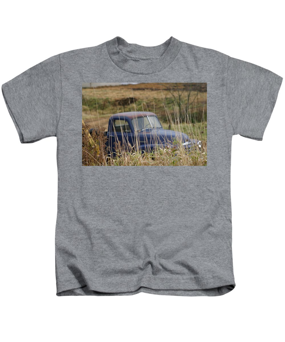 Backyards Kids T-Shirt featuring the photograph Backyard Blues by Bjorn Sjogren