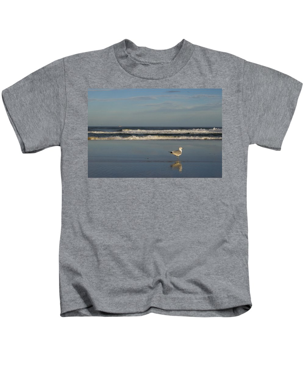 Sea Ocean Gull Bird Beach Reflection Water Wave Sky Kids T-Shirt featuring the photograph Beach Patrol by Andrei Shliakhau