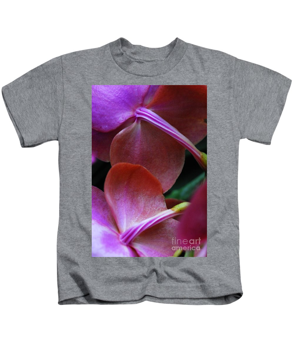 Orchid Kids T-Shirt featuring the photograph Behind The Orchids by Nancy Mueller