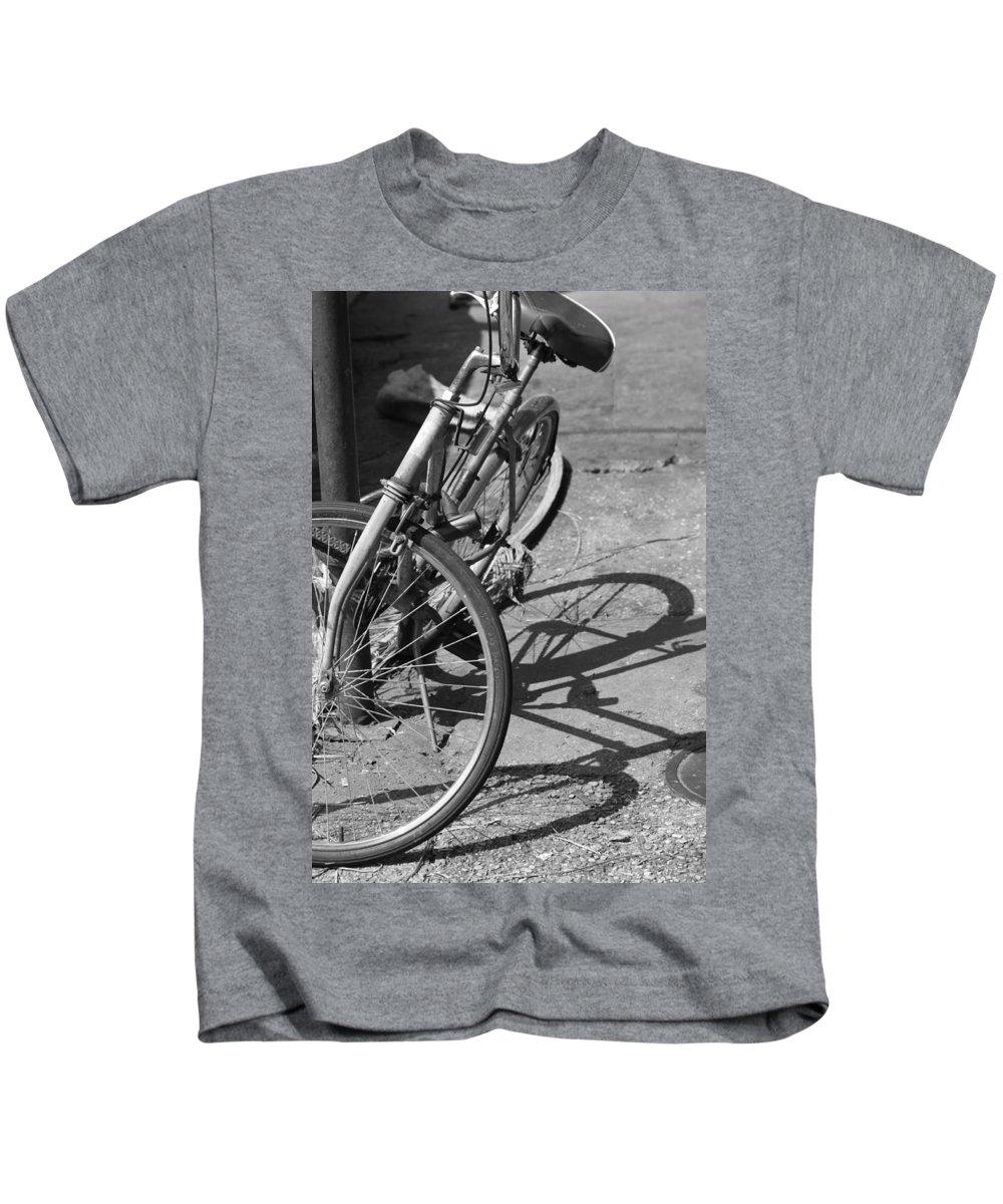 Bike Kids T-Shirt featuring the photograph Bike Shadow by Lauri Novak