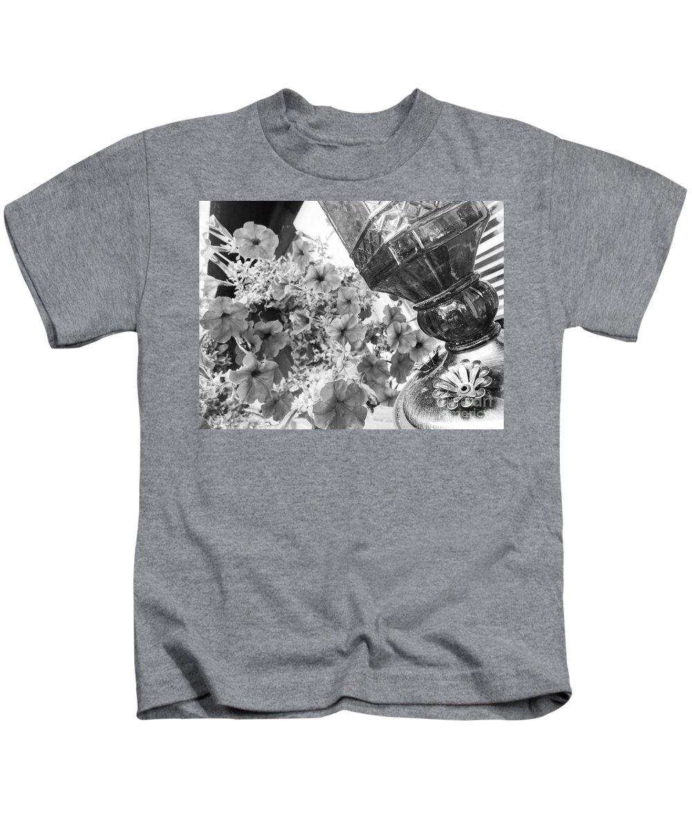Flowers Kids T-Shirt featuring the photograph Bird Feeder And Flowers by Korynn Neil
