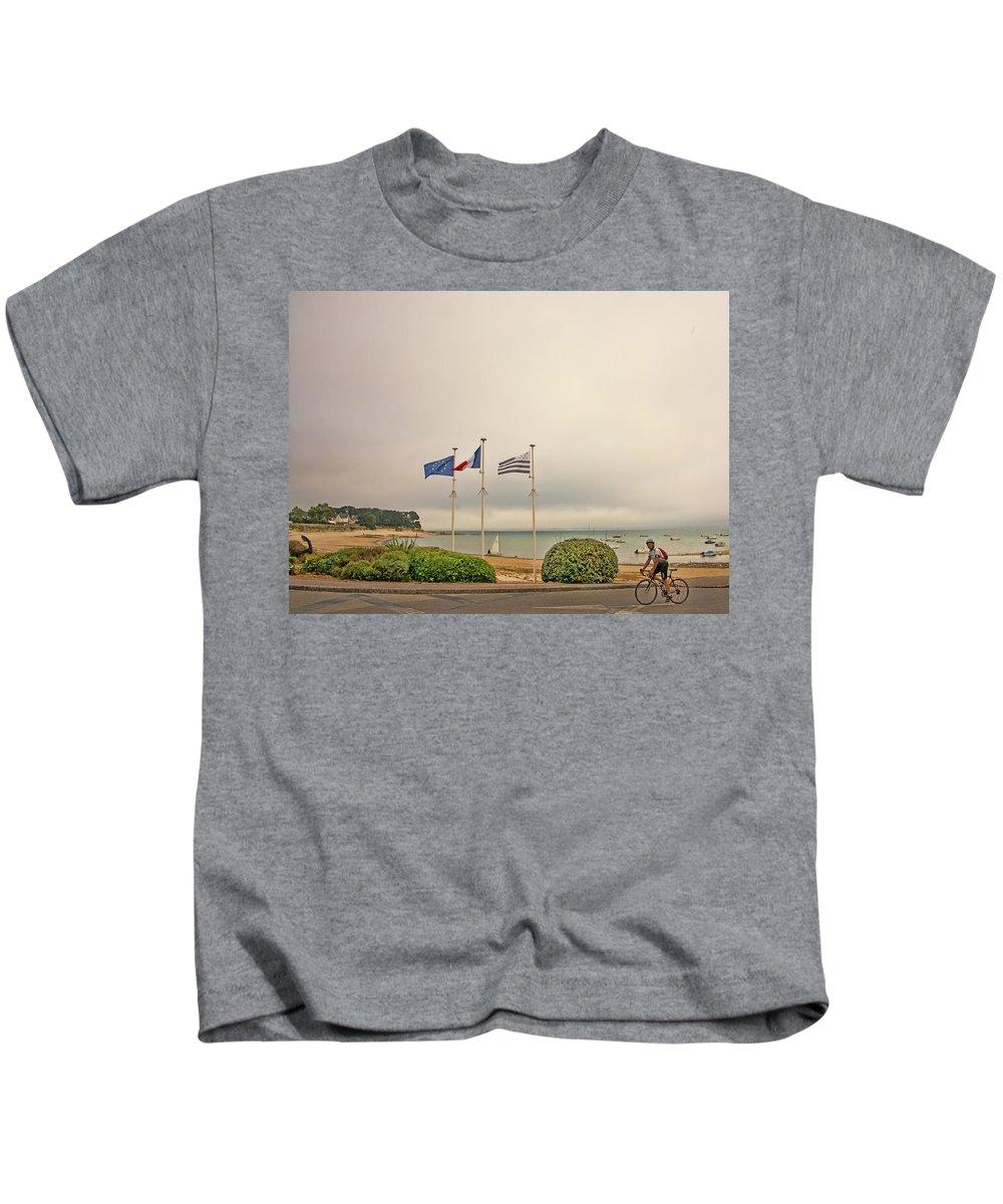 Camaret Sur Mer Kids T-Shirt featuring the photograph Camaret Sur Mer, Brittany, France, Bicyclist by Curt Rush