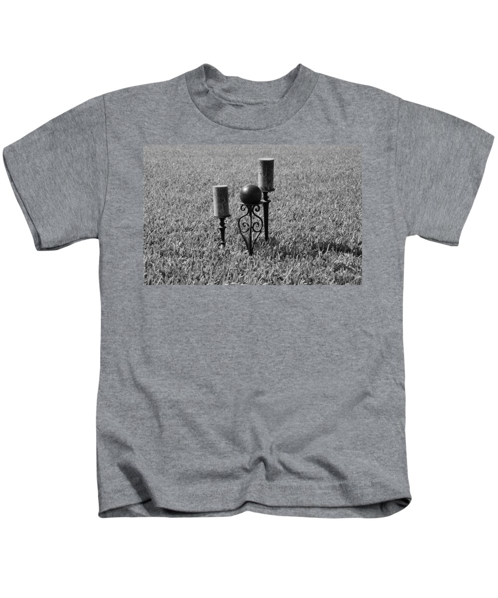 Black And White Kids T-Shirt featuring the photograph Candles In Grass by Rob Hans