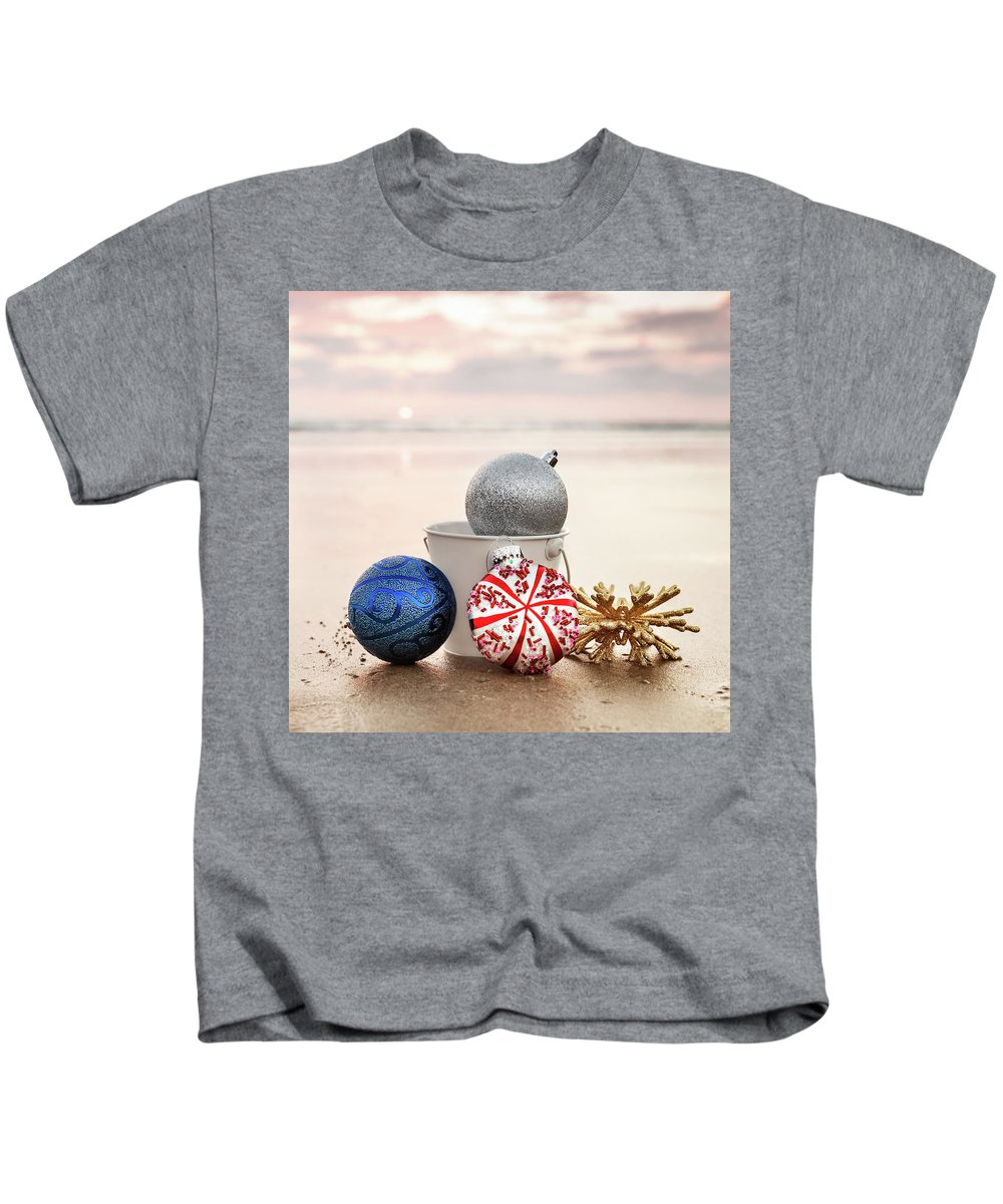 Evgeniya Lystsova Kids T-Shirt featuring the photograph Christmas Ornaments On The Beach by Evgeniya Lystsova