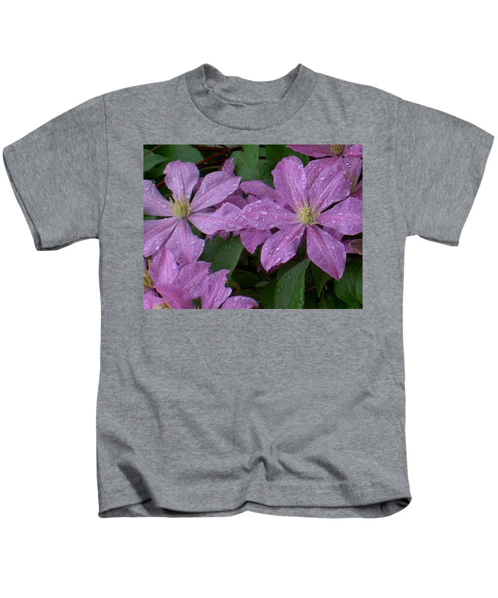Purple Kids T-Shirt featuring the photograph Clematis In The Rain by Carolyn Jacob