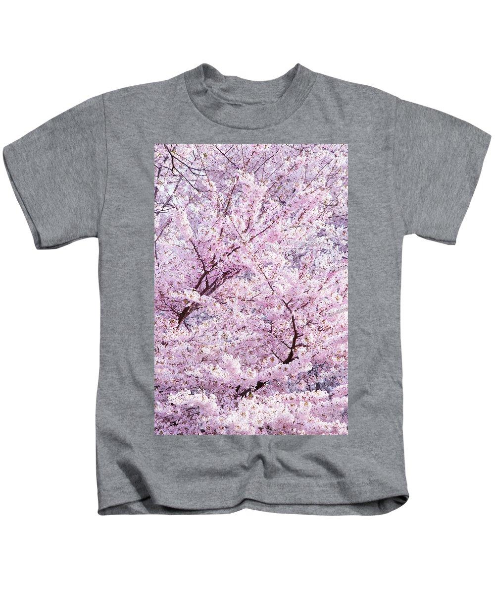 Cherry Blossom Kids T-Shirt featuring the photograph Dancing Sakura Haiku by Iryna Goodall