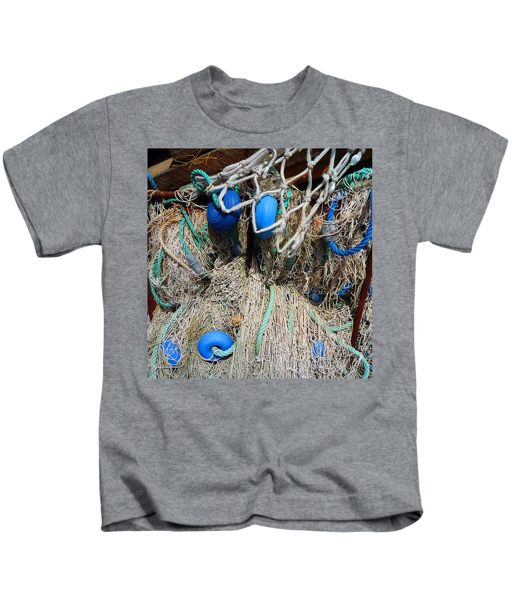 Fishing Net Kids T-Shirt featuring the photograph Deep Blue Discs by Charles Stuart