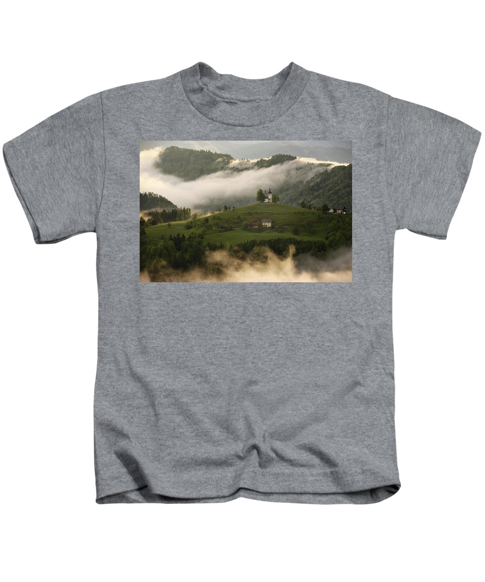 Sunrise Kids T-Shirt featuring the photograph Detail Of Rolling Fog At Sunrise In The Skofjelosko Hribovje Hil by Reimar Gaertner