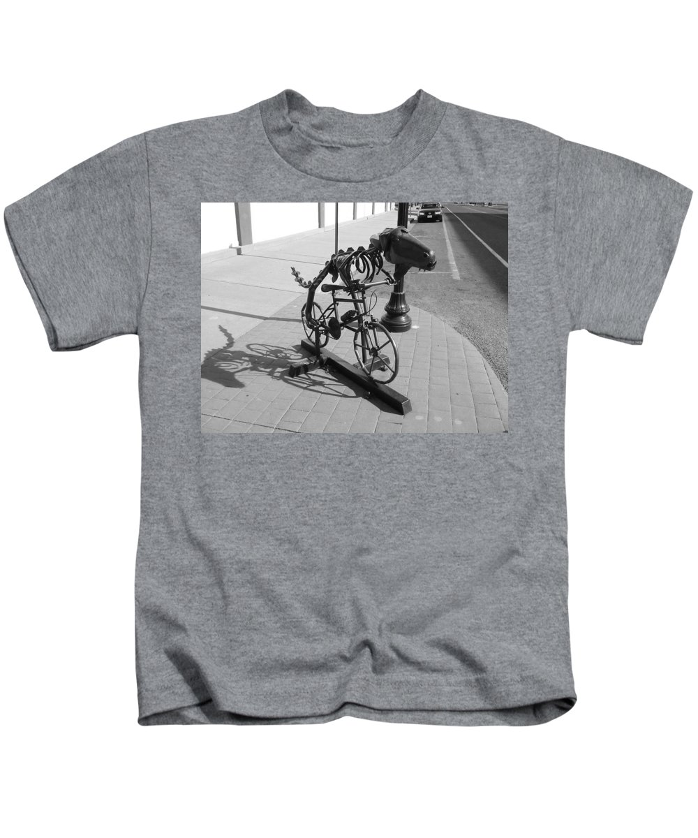 Dinosaur Biking Kids T-Shirt featuring the photograph Dinosaur Biking Sculpture Grand Junction Co by Tommy Anderson