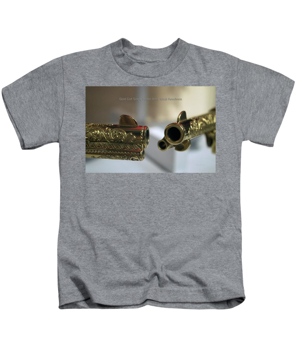 Antique Weapon Kids T-Shirt featuring the photograph Firearms Pair Of Gold Colt Single Action Army 45cal Revolvers by Thomas Woolworth