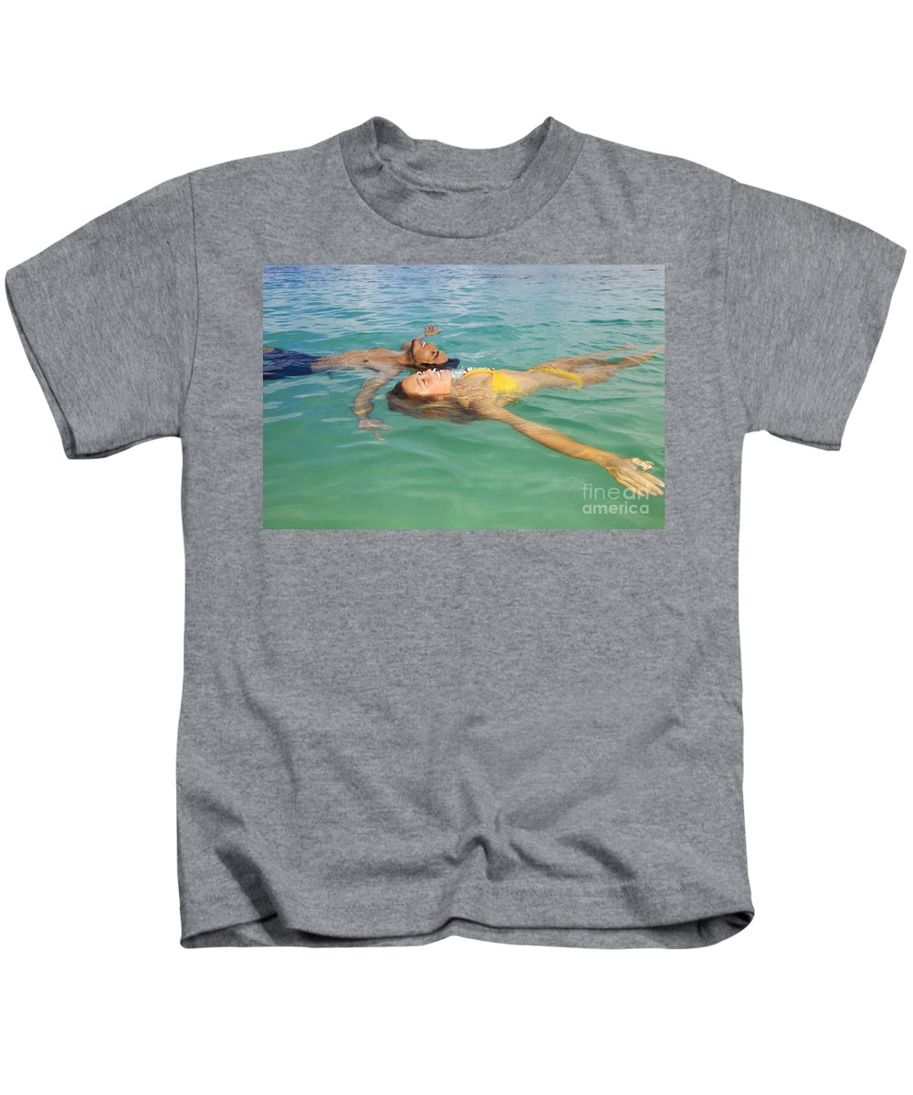 Asian Kids T-Shirt featuring the photograph Floating Young Couple by Tomas del Amo - Printscapes