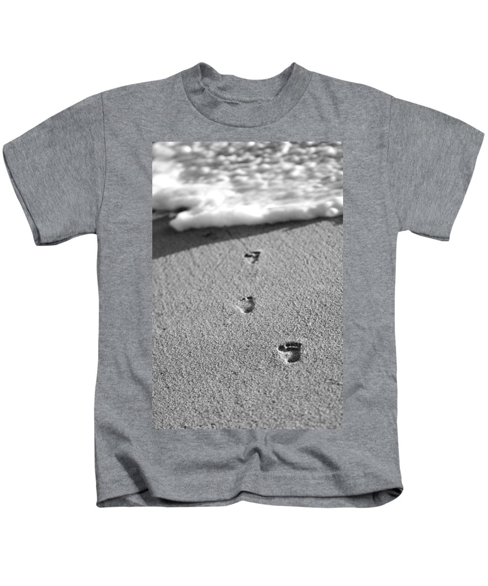 Sand Kids T-Shirt featuring the photograph Footprints In The Sand Black And White by Jill Reger