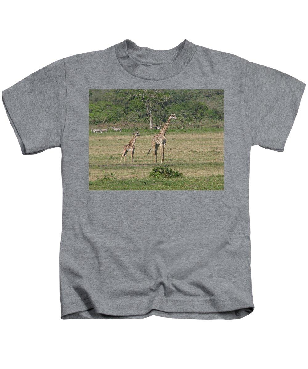 Giraffe Baby Africa Tanzania Mother Kids T-Shirt featuring the photograph Giraffe Baby by Diane Barone