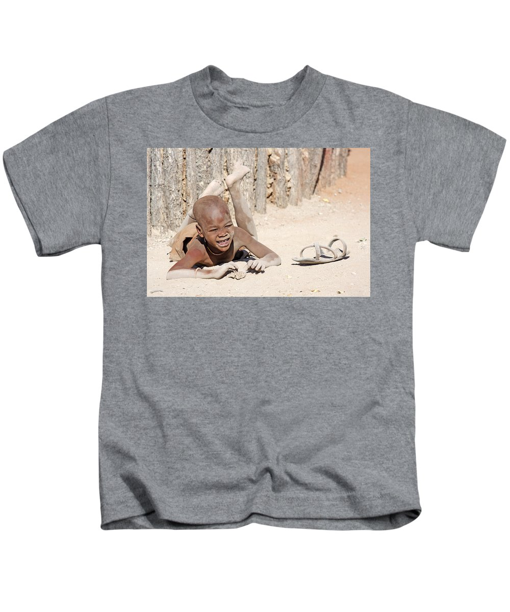 Himba Boy Kids T-Shirt featuring the photograph Himba Boy With Sandal by Aivar Mikko