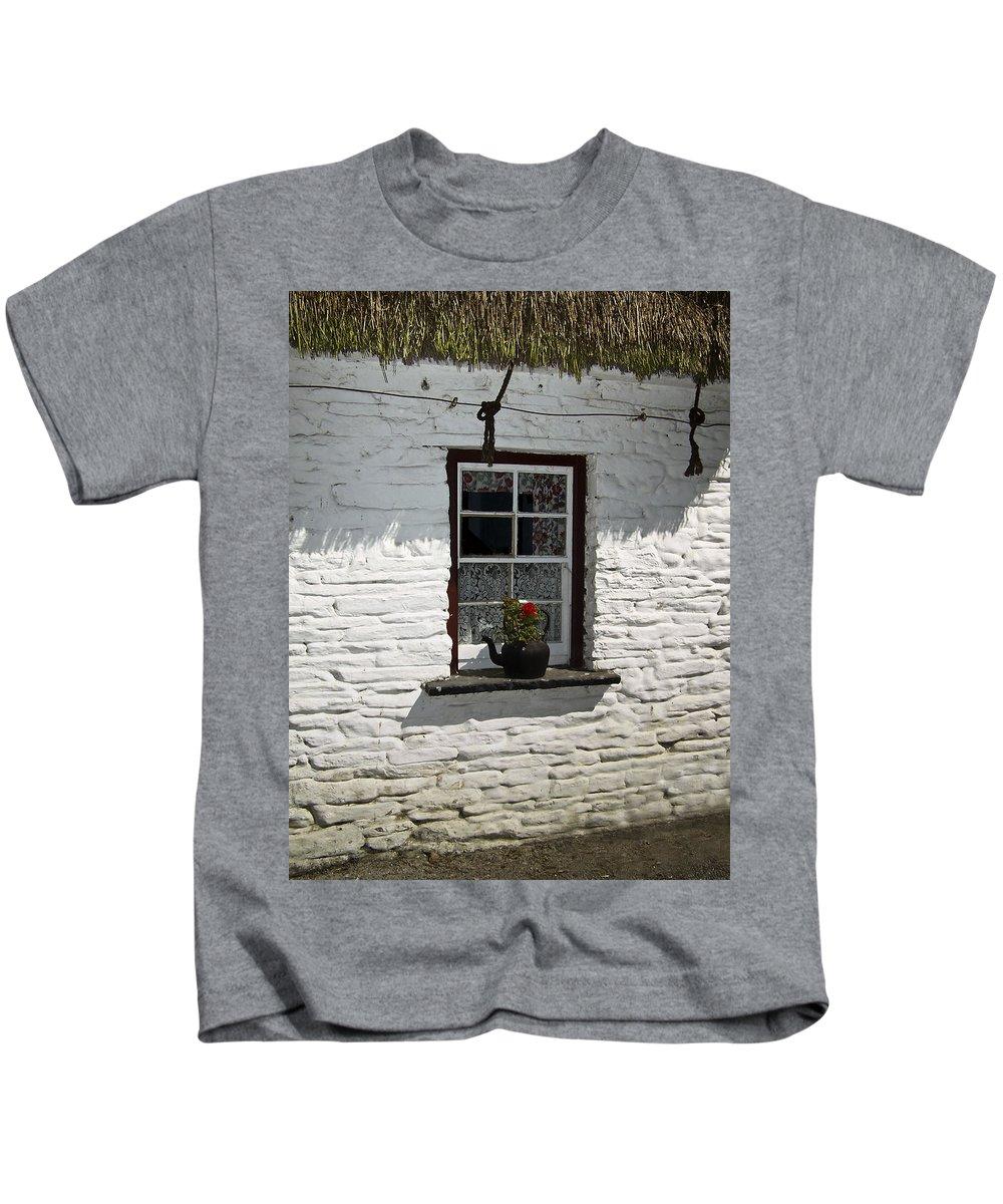 Irish Kids T-Shirt featuring the photograph Irish Kettle Of Geraniums County Cork Ireland by Teresa Mucha