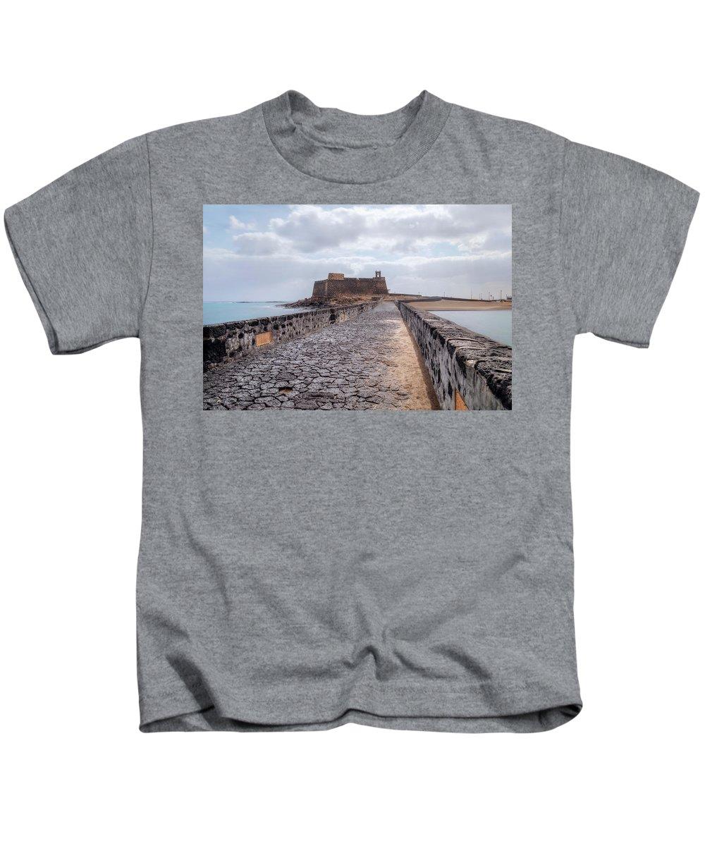 Castillo De San Gabriel Kids T-Shirt featuring the photograph Islote De Los Ingleses - Lanzarote by Joana Kruse