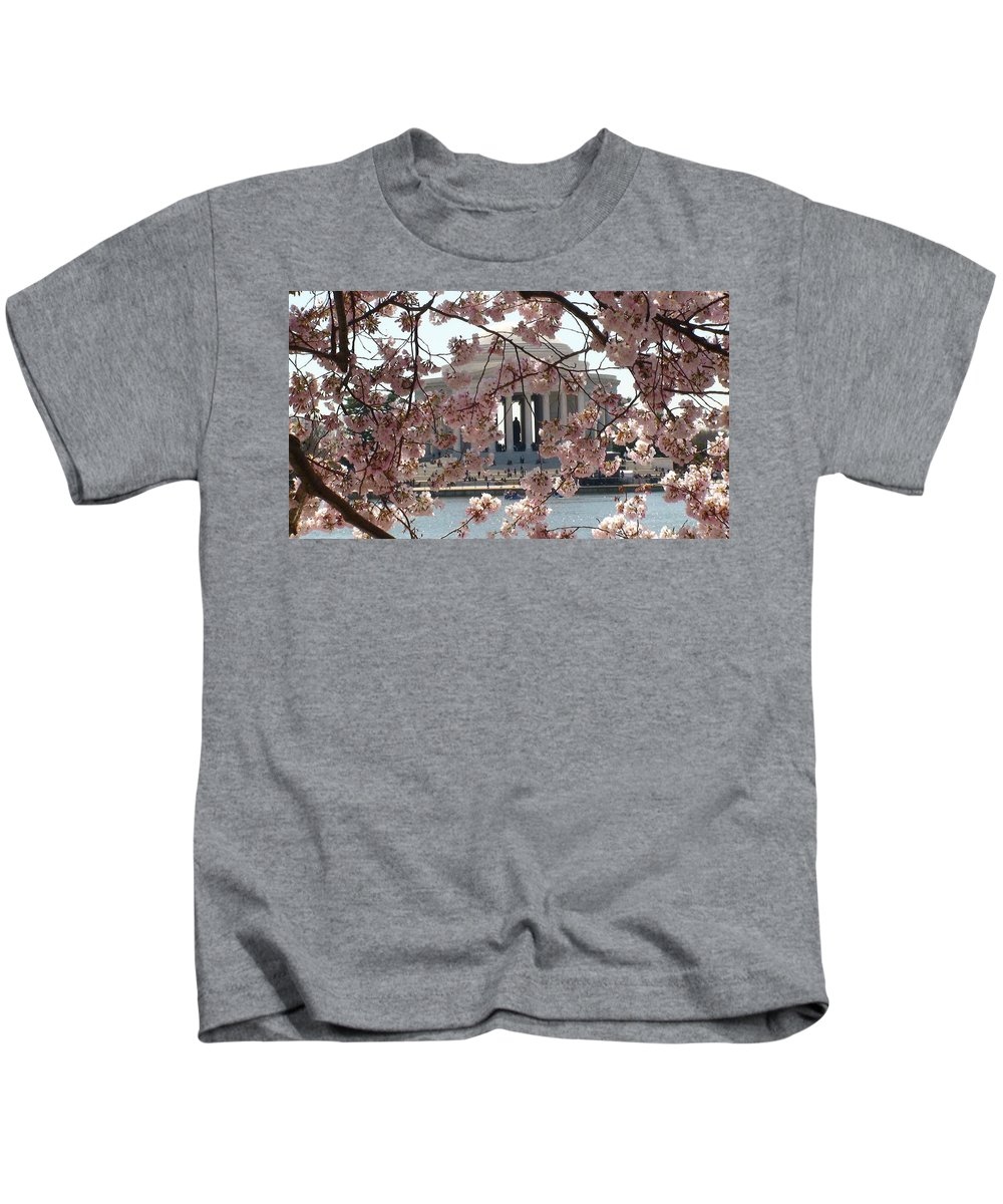 Jefferson Memorial Kids T-Shirt featuring the photograph Jefferson Through The Cherry Blossoms by Charles Kraus