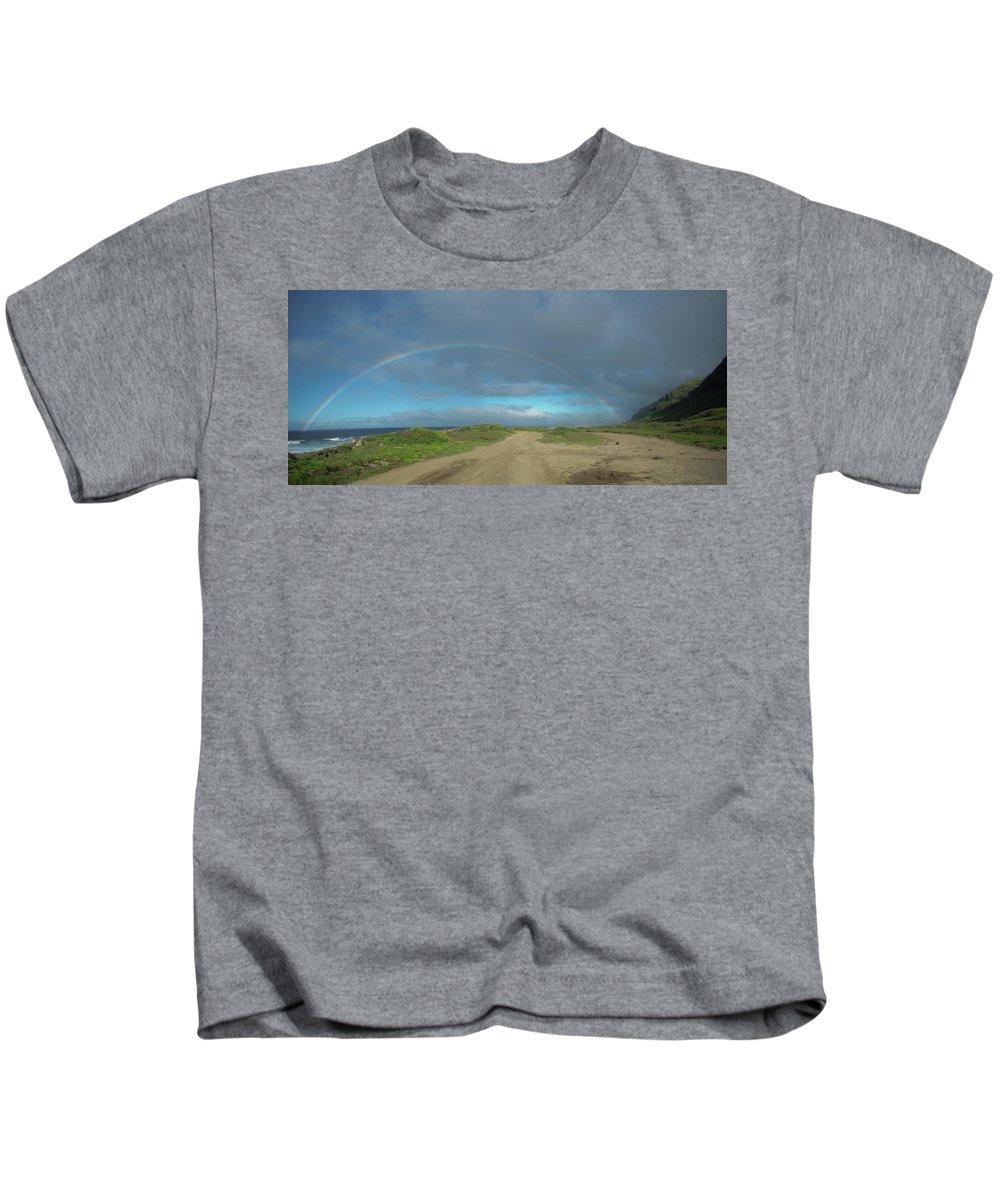 Rainbow Kids T-Shirt featuring the photograph Ka'ena Point Rainbow by Megan Martens