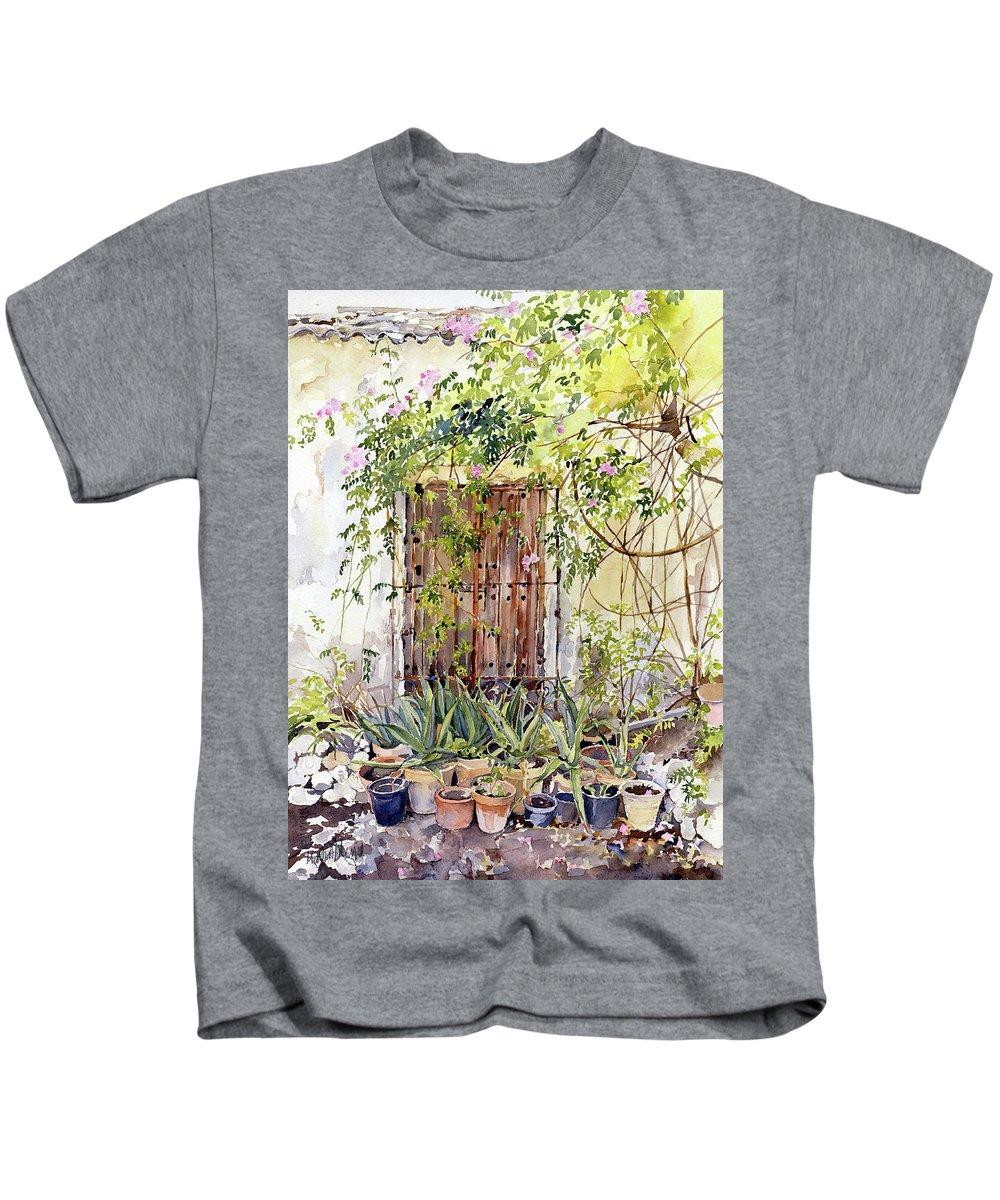 Almeria Kids T-Shirt featuring the painting La Puerta Vieja Y Macetas by Margaret Merry