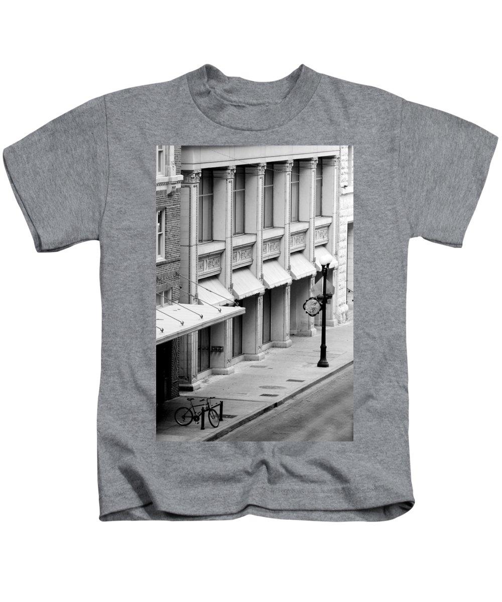 Architecture Kids T-Shirt featuring the photograph Loan Bike by Jill Reger