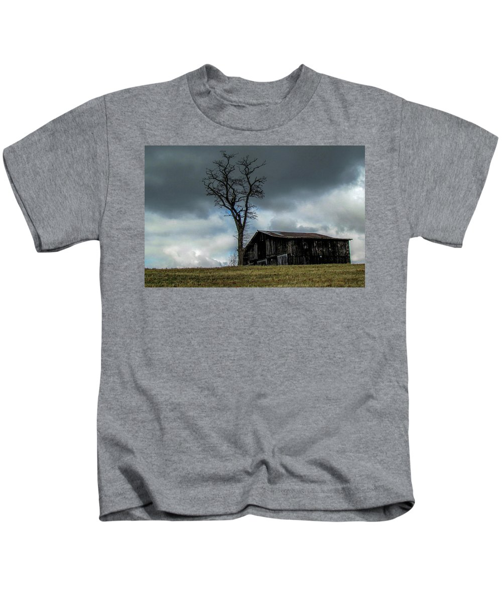 Barn Storm Lonely Landscape Country Kids T-Shirt featuring the photograph Lonely Barn by Judy Baird