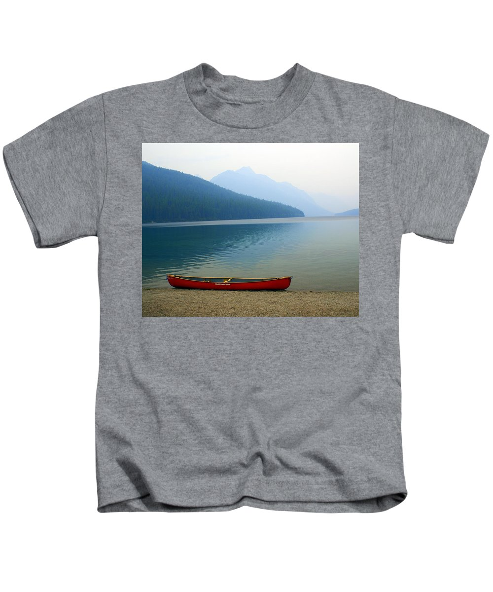 Glacier National Park Kids T-Shirt featuring the photograph Lonly Canoe by Marty Koch