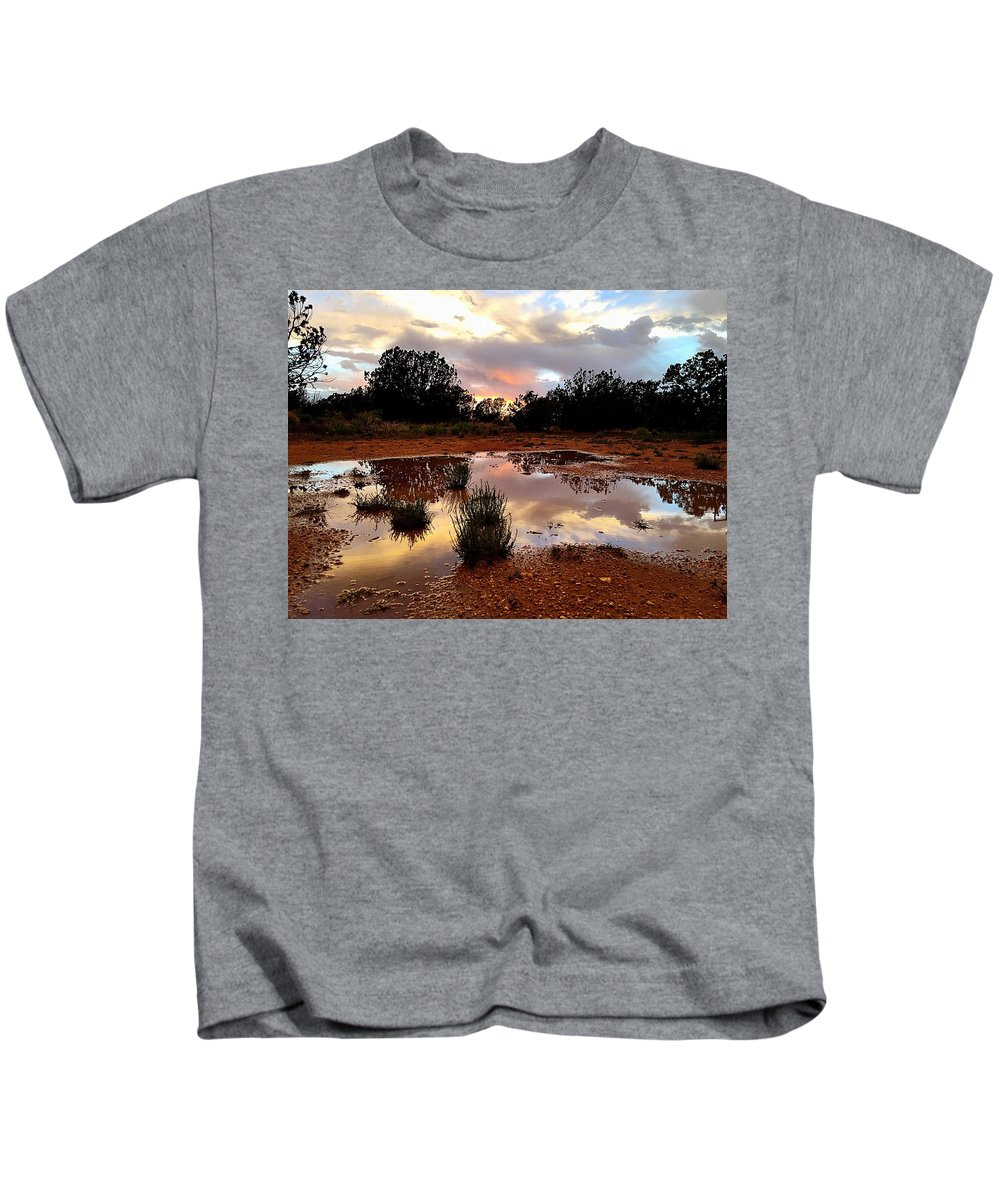Rain Kids T-Shirt featuring the photograph Magic In A Rain Puddle by Brad Hodges